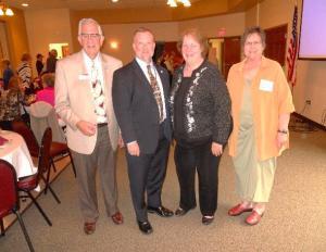 Dave Gynn, main speaker Jim Cain, AMBA representative, Carol Kinsey, DistrictXI Director, and Helena Parry, President