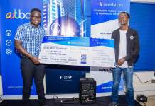 Ogwal Joseph; Founder and Chief Executive (Left), and Watson Atwine (Right); IT Specialist who represented the team, recivce their victory dummy air ticket at the Seedstar Kampala competition at Outbox Hub on Friday 24th, August 2018. This is Seedstars Kampala competition winners.
