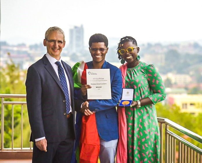 Neo Hutiri (center) accepting his Africa Prize for Engineering Innovation medal and a team certificate from Dr John Lazar CBE FREng (L) and Marieme Jamme (R) a Senegalese businesswoman at an award ceremony in Kampala on Tuesday June, 4th 2019. File Photo