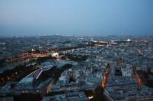 Lights turn on, upriver the Seine