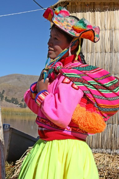 A young woman of the Uros with traditional dress