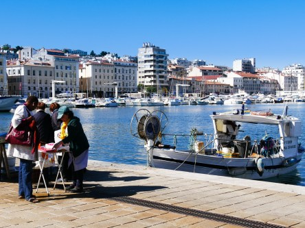 Fisherment bring their morning catch in the old port of Marseille
