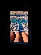 View through the hotel window to the old port of Marseille