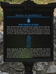 A small plaque with the brief history of the church. Only in French