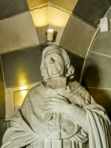 Statue of a cardinal or bishop in the crypt