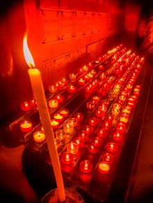 Candles in the crypt, in a devout atmosphere