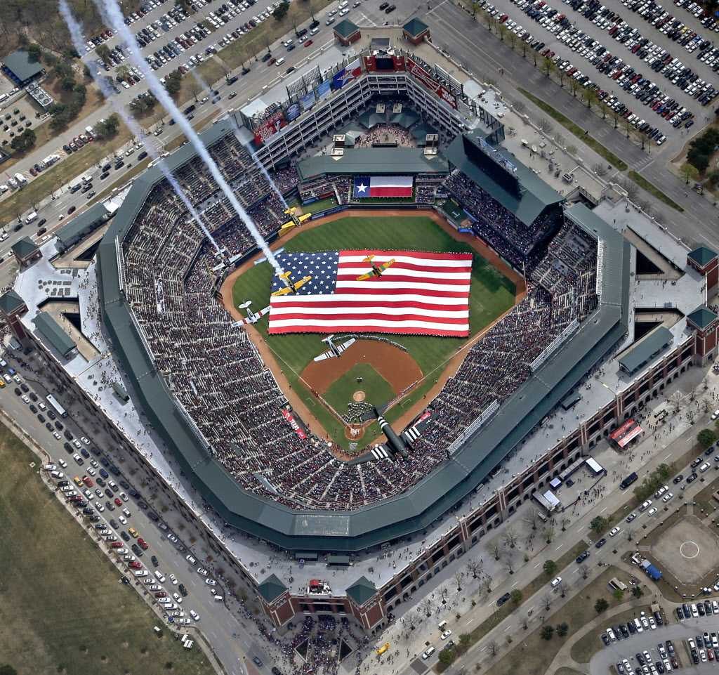 National anthem at opening day 2011 at the Ballpark in Arlington, where the Texas Rangers play. Many Americans salute the flag several times during August at U.S. major league ballparks. Photo: Texas Rangers/Examiner/Ben Werz. (How many displays in contravention of the U.S. Flag Code can you spot?)
