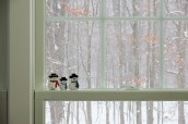snowman figurines on a window sill