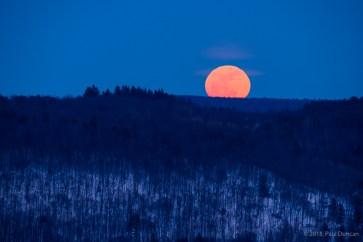 Winter full moon rising