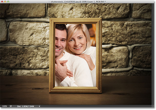 The photo is now clipped inside the frame. Image &Copy; 2012 Photoshop Essentials.com