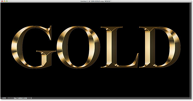 The gold letter effect after applying the Inner Glow layer style. Image © 2014 Photoshop Essentials.com