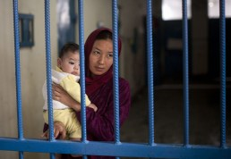 "Afghan prisoner Nuria, with her infant boy, at Badam Bagh, Afghanistan's central women's prison, in Kabul, on March 28, 2013. ""When I went to court for a divorce, instead of giving me a divorce, they charged me with running away,"" Nuria said. The man she wanted to marry was also charged and is now serving time in Afghanistan's notorious Pul-e-Charkhi prison. 202 women live in the six-year-old jail, the majority of the women are serving sentences of up to seven years for leaving their husbands, refusing to accept a marriage arranged by their parents, or choosing to leave their parents' home with a man of their choice. (AP Photo/Anja Niedringhaus) #"