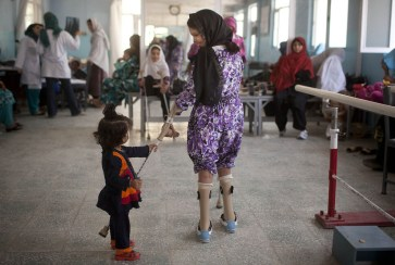 A young Afghan girl tries to grab the crutches of her sister Amida while she is testing her new artificial limbs at the ICRC physical rehabilitation center in Kabul, on May 27, 2012. Since the ICRC began its rehabilitation program in Afghanistan in 1988, over 43,000 people, including 25,000 amputees, have been treated at its centers in Kabul, Mazar-i-Sharif, Herat, Jalalabad and Gulbahar. Among the amputees registered, 77% were landmine victims and 70% civilians. (AP Photo/Anja Niedringhaus) #