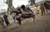 In a traditional game, Afghan men fight each other with slings in a park in the center of Kandahar, on February 11, 2011. (AP Photo/Anja Niedringhaus) #