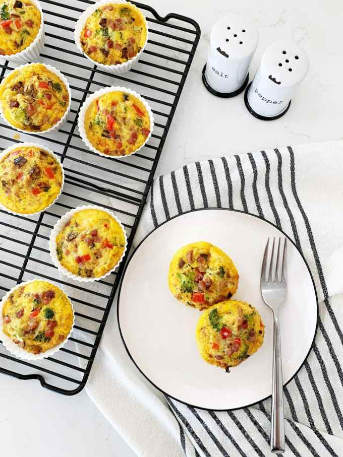 Overhead Shot of a cooling rack lined with meat and veggie egg muffins