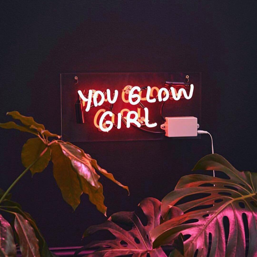 """a sign saying """"you glow girl"""" in pink"""
