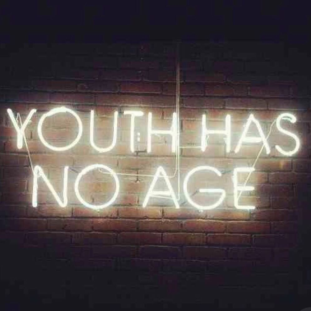 "A sign on a wall saying ""youth has no age"""