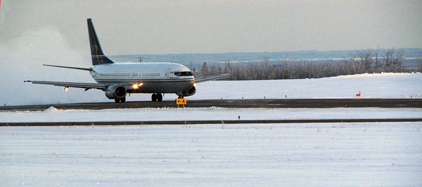 Plane landing at Peace River Regional Airport
