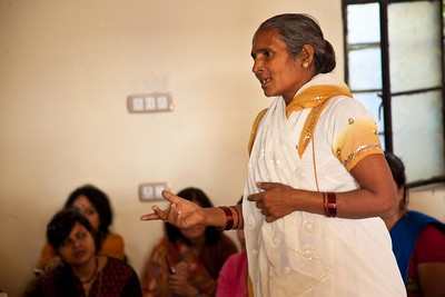 Photo Credit: UN Women/Gaganjit Singh. Mahendri Jadav from Vrindavan shares her struggles as a widow with the women from Nepal and Sri Lanka.