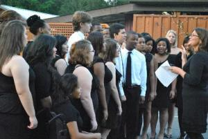 student singers gather outside in formal attire