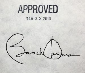 President Obama's signature on the affordable healthcare act