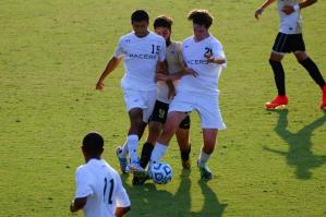 WPU students fighting for the ball during a soccer amtch.