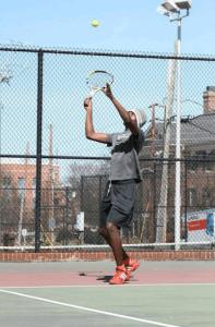 """"" tossing a tennis serve"