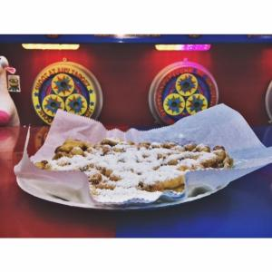 Funnel cake in front of fare game
