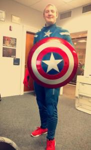 Peace student Johnny Everett stands in his Captain America costume with shield in Pressly 303