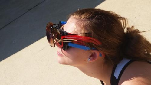 Girl wearing multiple sunglasses on top of each other