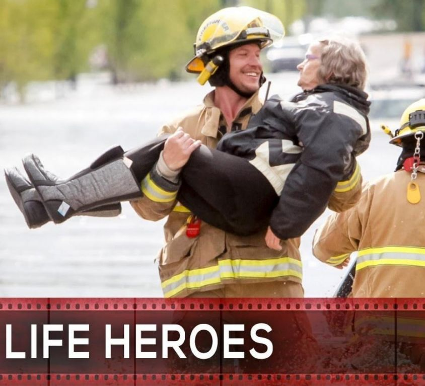 Fireman carrying old woman