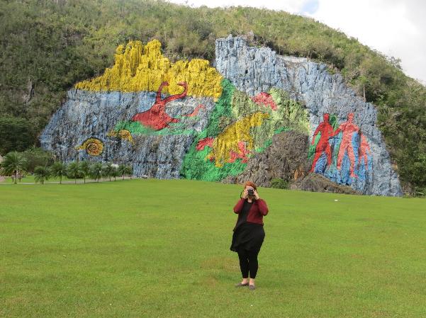 Professor Brenna Mickey taking a picture in Cuba