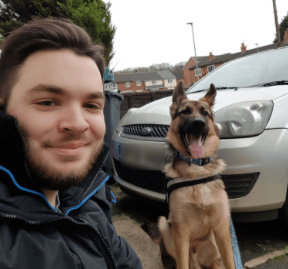 England resident and his dog outside during quarantine
