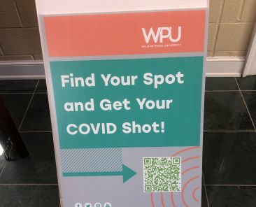 Signs around the WPU campus that encourage people to sign up for the vaccine.