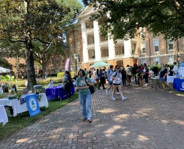 Students gather outside during Purpose @ Peace, which returned this year after missing a year due to the pandemic. Image by Jordyn Prince