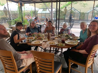 Dinner in Boulder with Rocky Mountain Peace & Justice Center—from left, Chris Allred, Giselle Herzfeld, Kristin from PeaceWorks KC, Usama Khalid, Betty Ball, Judith Mohling, Claire O'Brien.—Photo by Ann Suellentrop