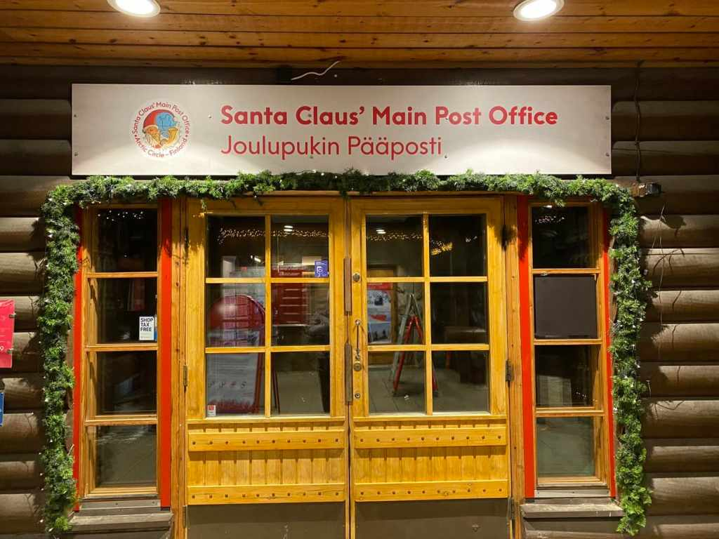 "Doors with sign that says ""Santa Claus' Main Post Office"""