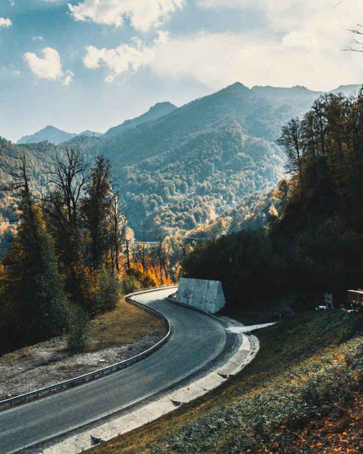 narrow asphalt road in mountainous area