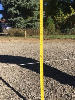 """The driveway already had a solid base. Additional base was needed to fill in spots that were low. 3"""" space was left for 3/8"""" decorative gravel."""