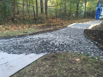 """Laying in the 3/4"""" gravel"""