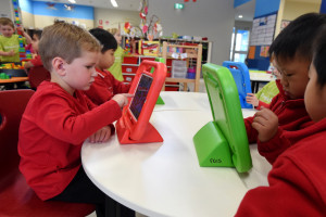 Kids play on iPads at Franklin Early Learning School in Canberra, Tuesday, May 19, 2015. Franklin Early Learning School is one of 41 centres across Australia taking part in the trial to look at new ways to help children explore languages other than English. (AAP Image/Lukas Coch) NO ARCHIVING