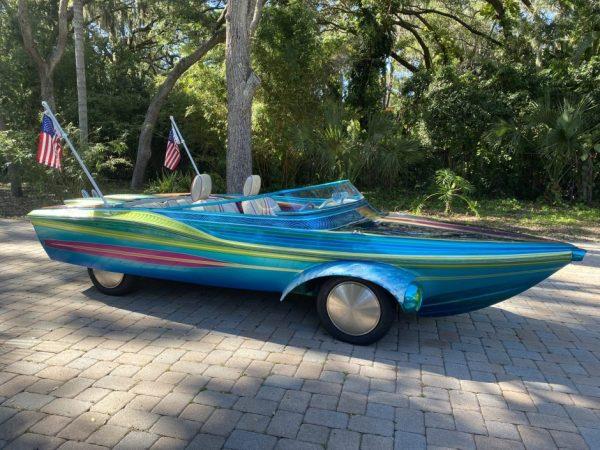 metallic blue land yacht for luxury cruising around the neighborhood