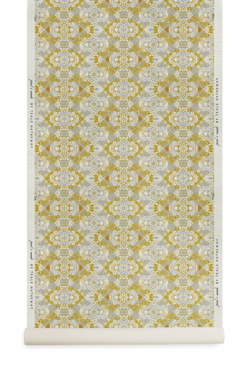 A roll of Pearl & Maude's abstract floral Carmen grasscloth wallcovering in daisy yellow and grey