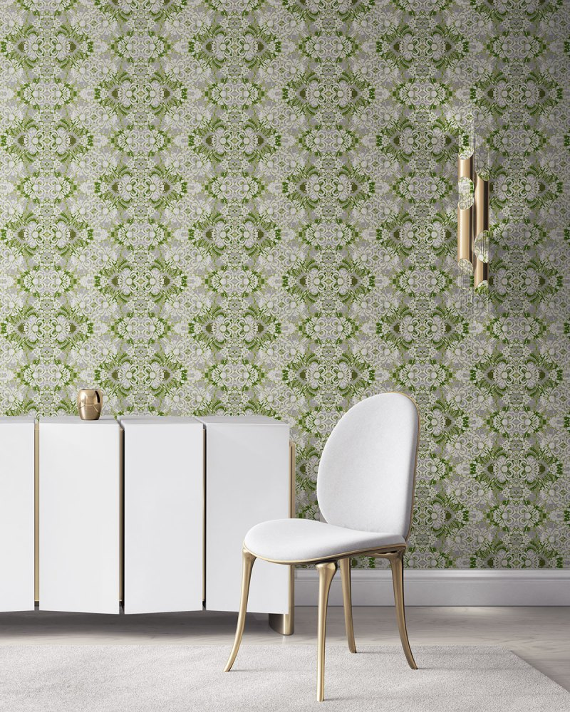 Pearl & Maude's abstract botanical Carmen grasscloth wallcovering in moss green and grey installed in a beautiful living room with white and brass furniture.