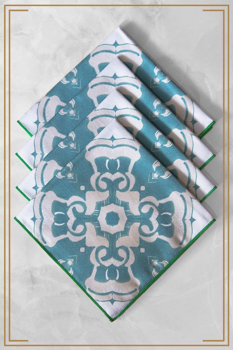 Alexandria Cloth Cocktail Napkin in sea blue is a fun, symmetrical pattern
