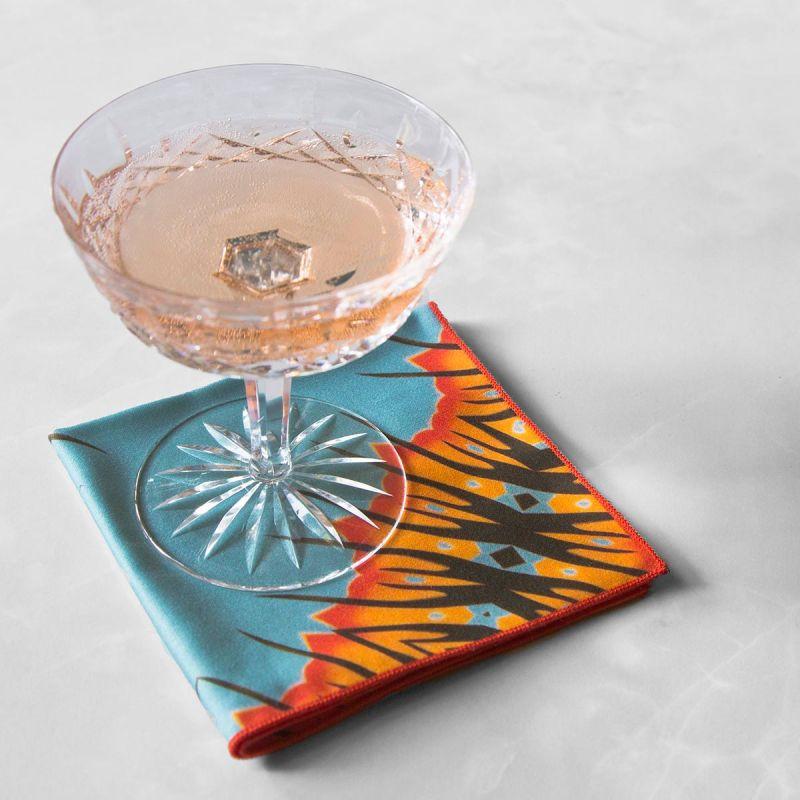 Desert Diamond Cloth Cocktail Napkin with a crystal wine glass.