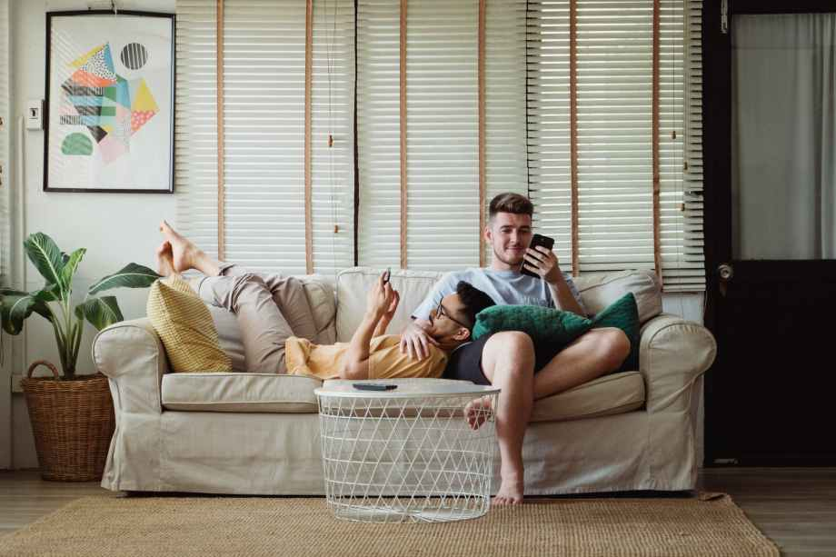 two men relaxing on a couch