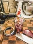 Pouring Balsamic Vinegar over sliced Onions