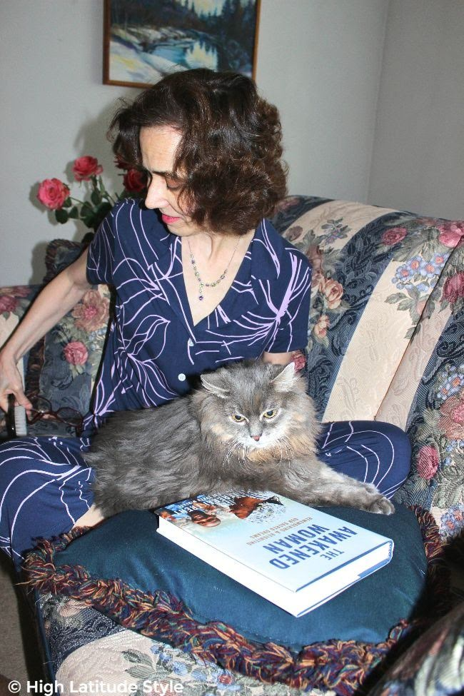 woman with cat and book