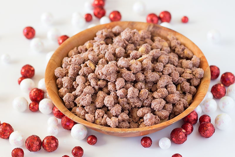 Cinnamon Vanilla Candied Peanuts in wooden bowl with red and white decorative balls